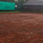 Sanierung Grundüberholung Tennisplatz nach Abtrag Deckschichten und Feinplannum