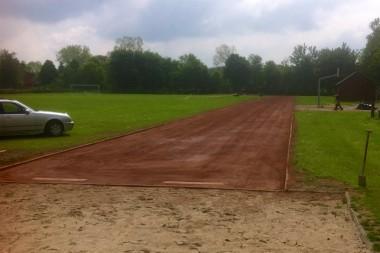 Sportplatzbau - Sanierung Laufbahn und Absprungsbalken