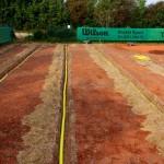 Sanierung Grundüberholung Tennisplatz -Einbau Entwässerung Tennisplatz - Einbau Drainage zur Entwässerung Tennisplatz